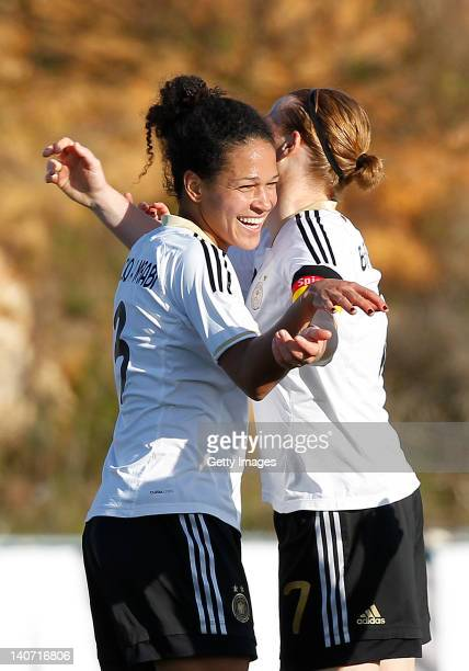 Celia Okoyno da Mbabi celebrates her goal with team mate Melanie Behringer of Germany during the Women Algarve Cup match between Germany and Sweden...