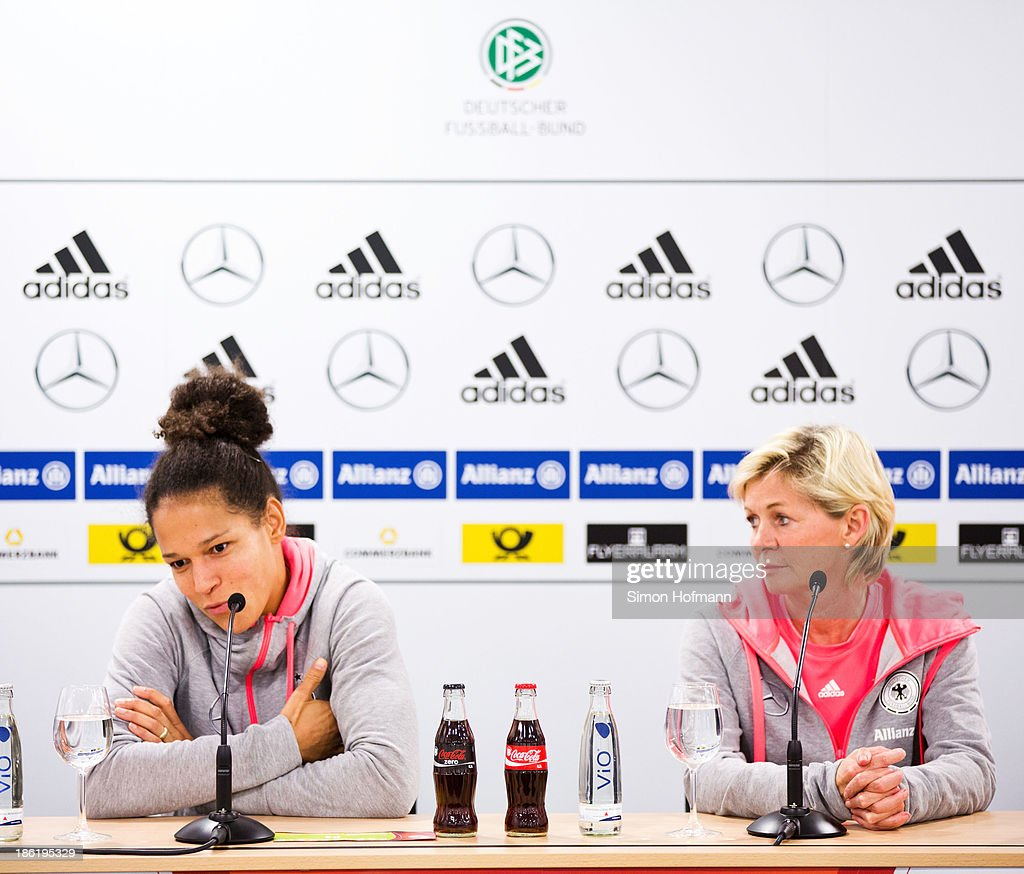 Celia Sasic (L) and head coach Silvia Neid (R) attend a Germany women's press conference at Volksbank Stadion on October 29, 2013 in Frankfurt am Main, Germany.