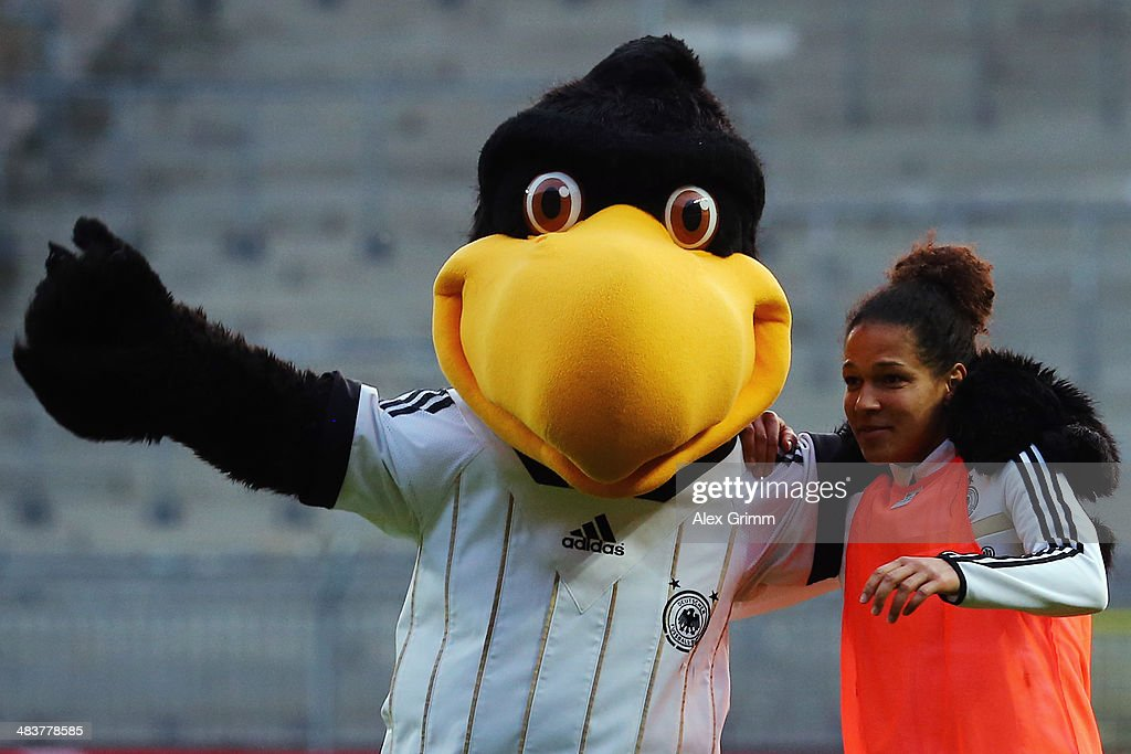 Celia Sasic of Germany ceelbrates with mascot 'Paule' after the FIFA Women's World Cup 2015 qualifying match between Germany and Slovenia at Carl-Benz-Stadion on April 10, 2014 in Mannheim, Germany.