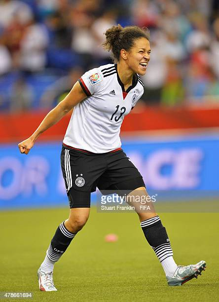 Celia Sasic of Germany celebrate winning the quarter final match of the FIFA Women's World Cup between Germany and France at Olympic Stadium on June...