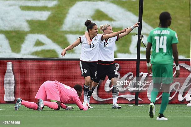 Celia Sasic of Germany celebrates as she scores the second goal goal during the FIFA Women's World Cup Canada 2015 Group B match between Germany and...