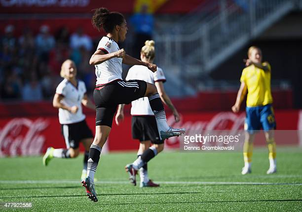 Celia Sasic of Germany celebrates as she scores the third goal during the FIFA Women's World Cup Canada 2015 Round of 16 match between Germany and...