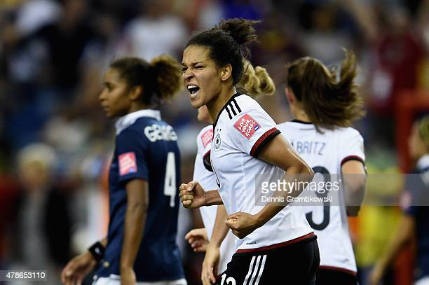 Celia Sasic of Germany celebrates as she scores their first goal from a penalty during the FIFA Women's World Cup Canada 2015 Quarter Final match...