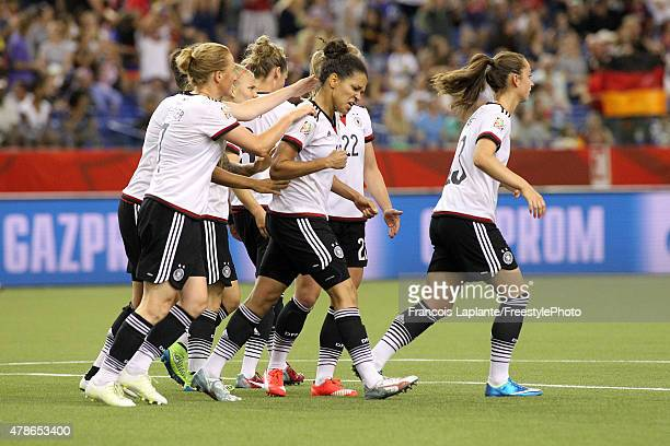Celia Sasic of Germany celebrates her goal with teammates against France during the FIFA Women's World Cup Canada 2015 quarter final match between...