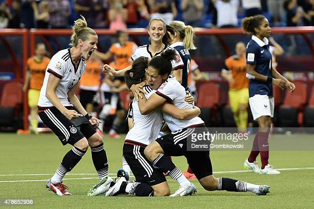 Celia Sasic of Germany celebrates with team mates as she scores their first goal from a penalty during the FIFA Women's World Cup Canada 2015 Quarter...