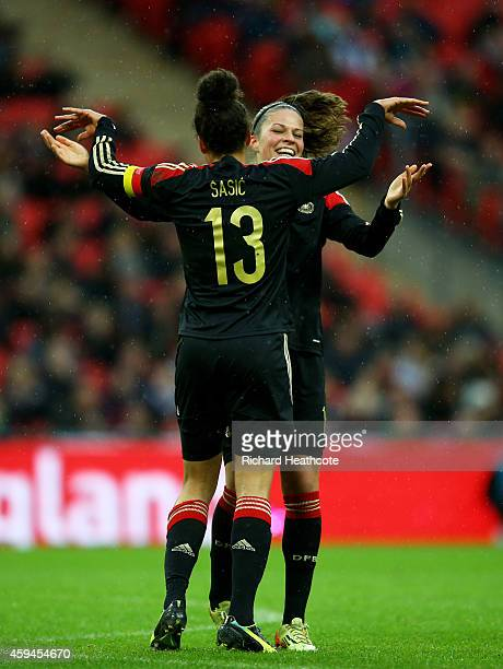 Celia Sasic of Germany celebrates with teammate Melanie Leupolz of Germany after scoring her team's second goal during the Women's International...