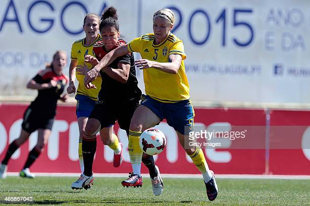 Celia Sasic of Germany challenges Nilla Fischer of Sweden during the Women's Algarve Cup 3rd place match between Sweden and Germany at Municipal...