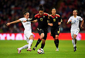 Celia Sasic of Germany is tackled by Fara Williams of England during the Women's International Friendly match between England and Germany at Wembley...