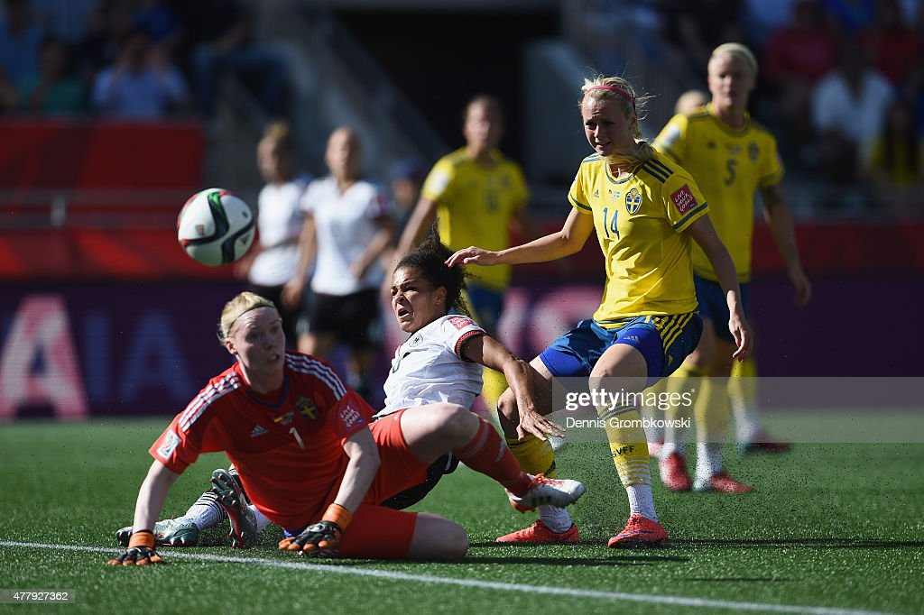 Celia Sasic of Germany misses a chance at goal under the pressure of Hedvig Lindahl and Amanda Ilestedt of Sweden during the FIFA Women's World Cup Canada 2015 Round of 16 match between Germany and Sweden at Lansdowne Stadium on June 20, 2015 in Ottawa, Canada.