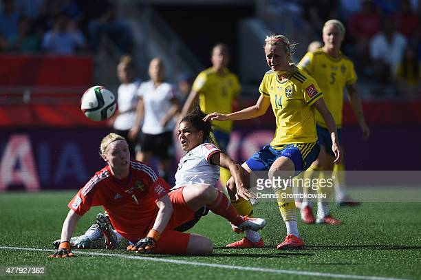 Celia Sasic of Germany misses a chance at goal under the pressure of Hedvig Lindahl and Amanda Ilestedt of Sweden during the FIFA Women's World Cup...
