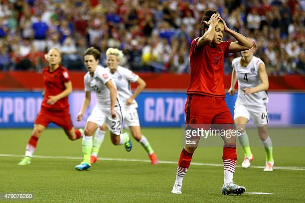 Celia Sasic of Germany reacts after missing a penalty kick against the United States in the second half in the FIFA Women's World Cup 2015 SemiFinal...