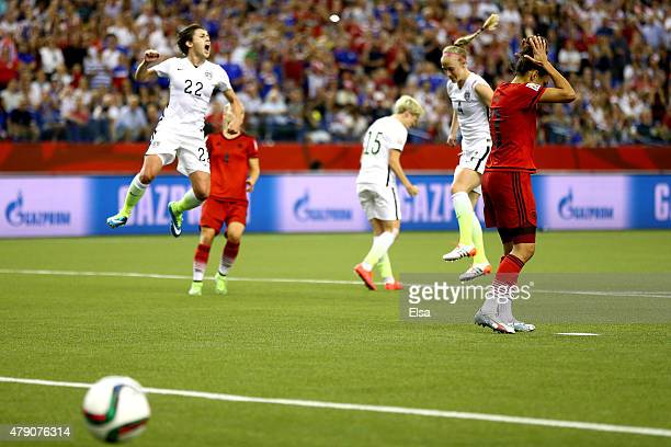 Celia Sasic of Germany reacts after missing a penalty kick as Meghan Klingenberg of the United States celebrates in the second half in the FIFA...
