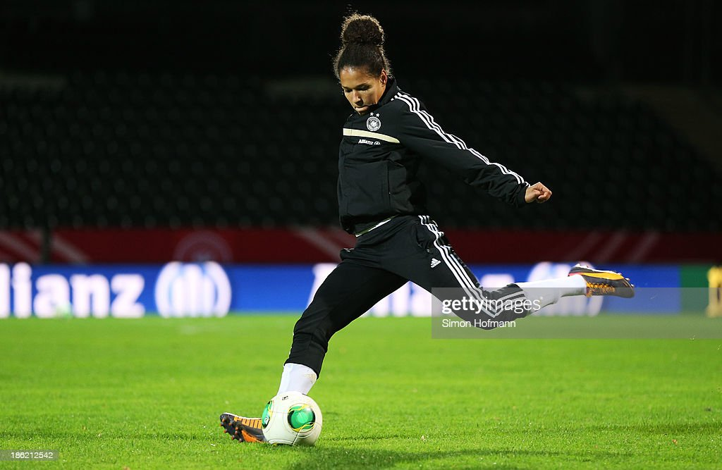 Celia Sasic of Germany runs with the ball during a Germany training session at Volksbank Stadion on October 29, 2013 in Frankfurt am Main, Germany.