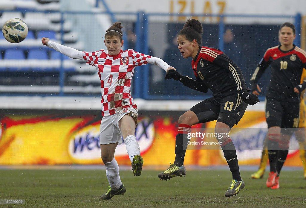 Celia Sasic (R) of Germany scores the goal near Vanesa Zlosa (L) of Croatia during the FIFA Women's World Cup 2015 Qualifier between Croatia and Germany at Stadion Gradski Vrt on November 27, 2013 in Osijek, Croatia.