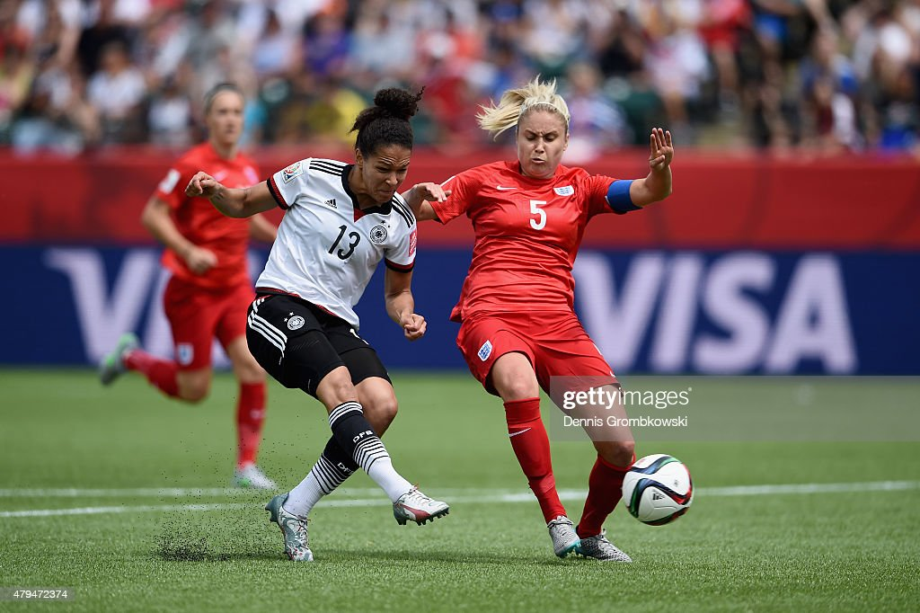 Celia Sasic of Germany takes a shot at goal past Steph Houghton of England during the FIFA Women's World Cup Canada 2015 Third Place Playoff match...