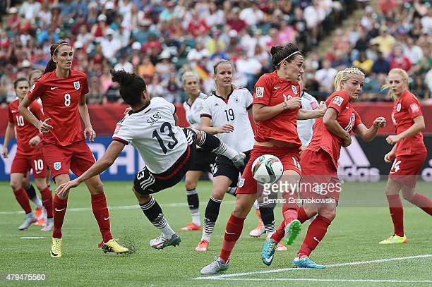 Celia Sasic of Germany takes a shot during the FIFA Women's World Cup Canada 2015 Third Place Playoff match between Germany and England at...