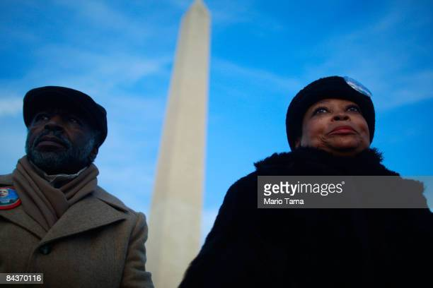Celiah Shareef and Theo Muhammad Abdullah both of North Carolina wait at the Washington Monument during the inauguration of Barack Obama as the 44th...