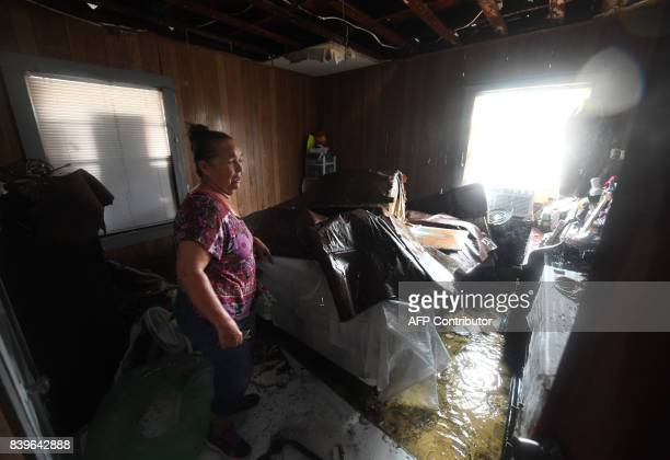 Celina Martinez returns to find their family home badly damaged after Hurricane Harvey hit Rockport Texas on August 26 2017 / AFP PHOTO / MARK RALSTON