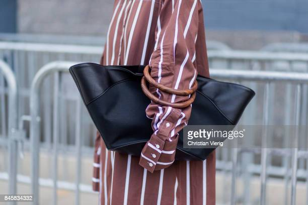 Celine Aagaard wearing a black bag striped dress seen in the streets of Manhattan outside Zimmermann during New York Fashion Week on September 11...