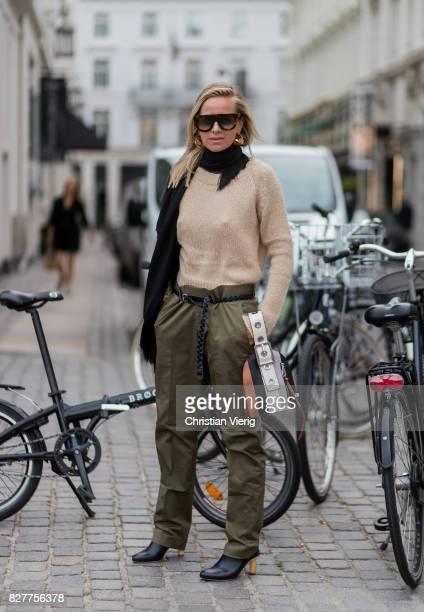 Celine Aagaard wearing a black scarf beige knit olive pants with belt outside Designers Nest on August 8 2017 in Copenhagen Denmark