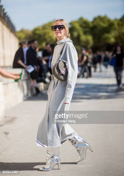 Celine Aagaard wearing silver boots grey dress is seen outside Nina Ricci during Paris Fashion Week Spring/Summer 2018 on September 29 2017 in Paris...