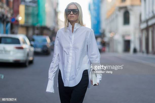 Celine Aagaard wearing white button shirt black pants and boots outside Line of Oslo on August 22 2017 in Oslo Norway
