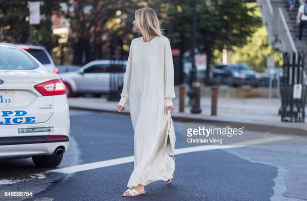 Celine Aagaard wearing white dress seen in the streets of Manhattan outside Michael Kors during New York Fashion Week on September 13 2017 in New...