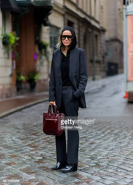 Celine Aargaard wearing a black hoody black blazer and bordeaux bag outside By Malina during the first day of the Stockholm Fashion Week...