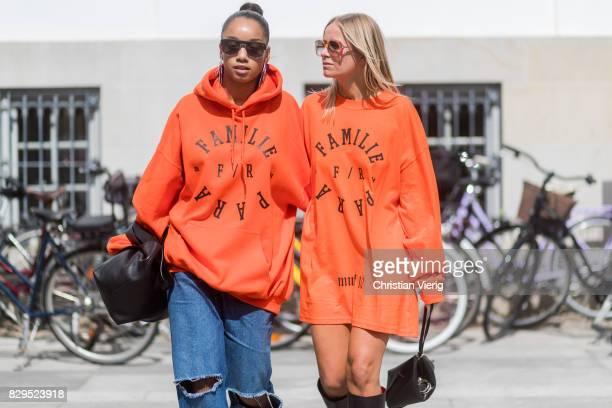 Celine Aargaard wearing orange hoody Familie Paris outside Baum Und Pferdgarten on August 10 2017 in Copenhagen Denmark