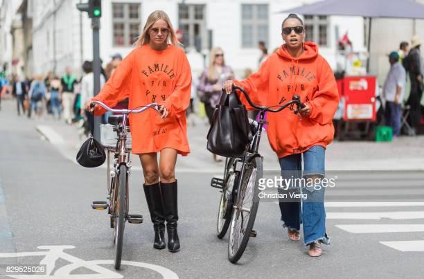 Celine Aargaard with her bike wearing orange hoody Familie Paris outside Baum Und Pferdgarten on August 10 2017 in Copenhagen Denmark