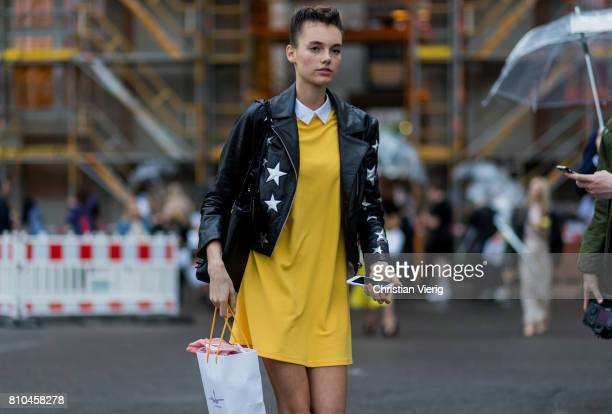 Celine Bethmann wearing a yellow dress black leather jacket outside Marina Hoermanseder during the MercedesBenz Fashion Week Berlin Spring/Summer...