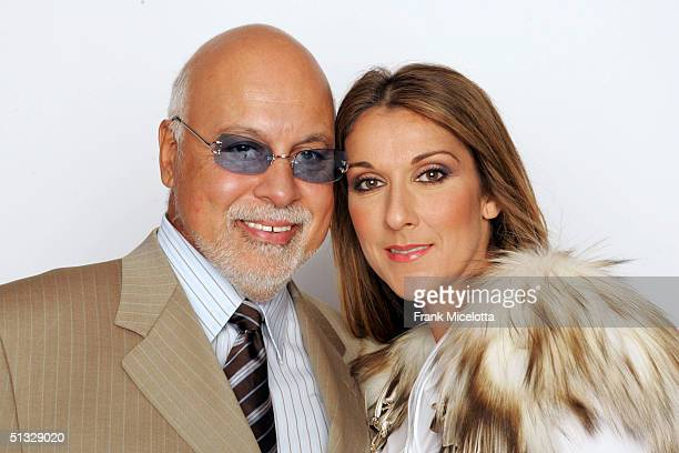 Celine Dion and her husband Rene Angelil pose for a picture backstage during the 2004 World Music Awards at the Thomas and Mack Center on September...