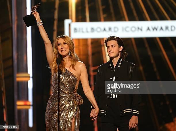 Celine Dion and Rene Charles are seen on stage during the 2016 Billboard Music Awards held at the TMobile Arena on May 22 2016 in Las Vegas Nevada
