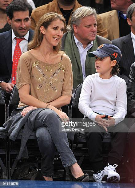 Celine Dion and son Rene Charles Angelil attend the Portland Trailblazers Vs New York Knicks game at Madison Square Garden on December 7 2009 in New...