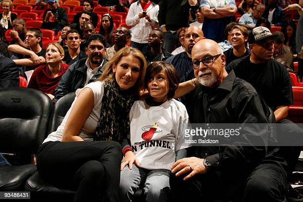 Celine Dion her son and her husband Rene Angelil watch the Miami Heat play against the Boston Celtics on November 29 2009 at American Airlines Arena...