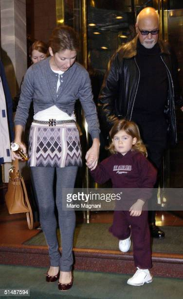 Celine Dion leaves for the airport from a midtown hotel with her husband Rene Angelil and their son Rene Jr October 16 2004 in New York City