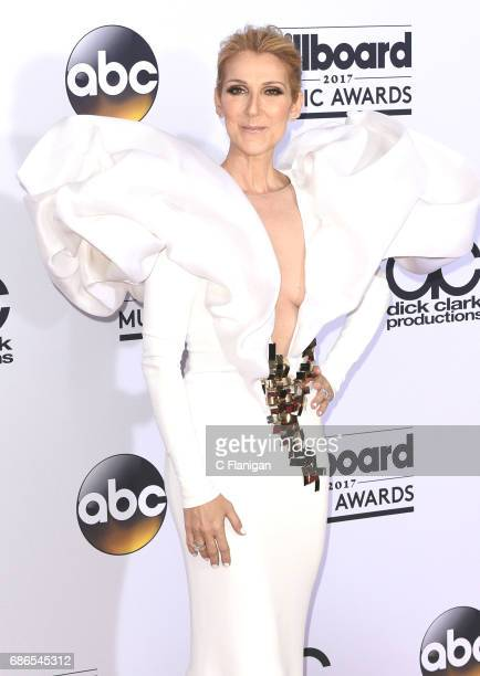 Celine Dion poses backstage in the press room during the 2017 Billboard Music Awards at TMobile Arena on May 21 2017 in Las Vegas Nevada