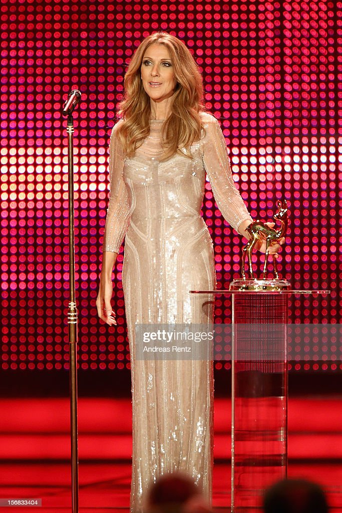 Celine Dion receives a Bambi from Peter Maffay during the 'BAMBI Awards 2012' at the Stadthalle Duesseldorf on November 22, 2012 in Duesseldorf, Germany.