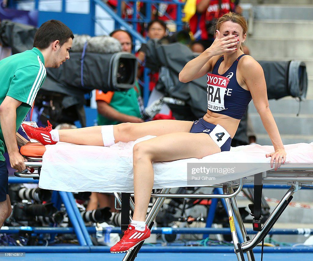 Celine Distel-Bonnet of France on a stretcher after the Women's 4x100 metres final during Day Nine of the 14th IAAF World Athletics Championships Moscow 2013 at Luzhniki Stadium on August 18, 2013 in Moscow, Russia.
