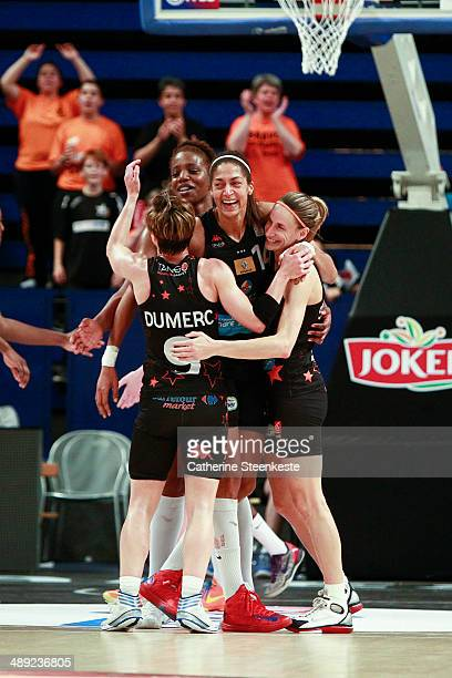 Celine Dumerc and her teammates of Bourges Basket are celebrating the victory of the French Final Cup game between ESB Villeneuve d'Ascq and Bourges...
