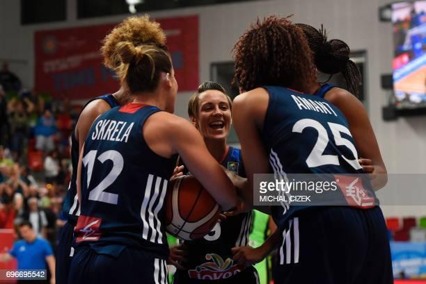 Celine Dumerc of France and her teammates celebrate after the FIBA EuroBasket women's basketball match Slovania v France on June 16 2017 in Prague...