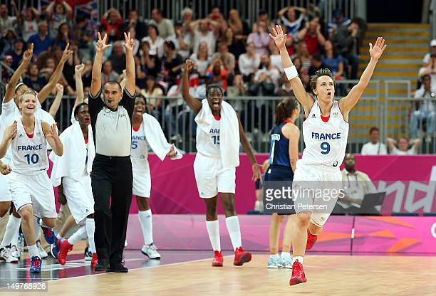 Celine Dumerc of France celebrates after hitting the go ahead basket in the final moments of overtime in the Women's Basketball Preliminary Round...