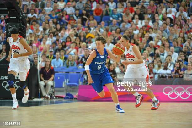 Celine Dumerc of France dribbles against the United States during their Basketball Game on Day 15 of the London 2012 Olympic Games at the North...