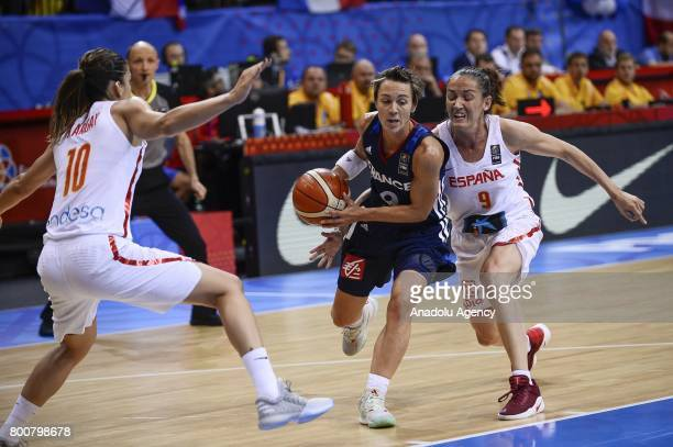 Celine Dumerc of France in action against Laia Palau and Marta Zargay of Spain during the 2017 FIBA EuroBasket Women gold medal match between Spain...
