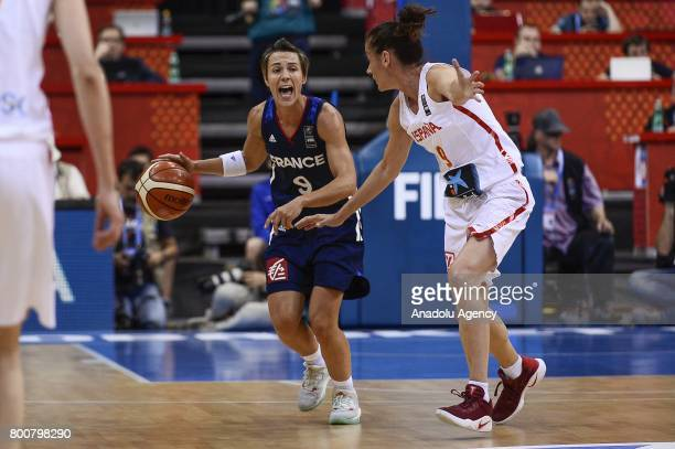 Celine Dumerc of France in action against Laia Palau of Spain during the 2017 FIBA EuroBasket Women gold medal match between Spain and France at...