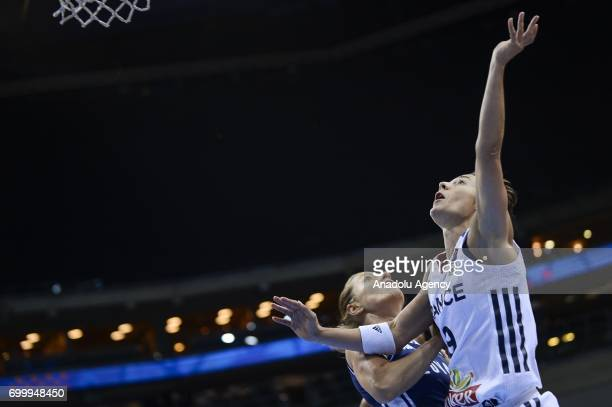 Celine Dumerc of France in action against Romana Vynuchalova of Slovakia during the 2017 FIBA EuroBasket Women quarterfinals match between France and...