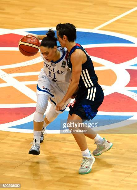 Celine Dumerc of France tries to block Angeliki Nikolopoulou of Greece during the FIBA EuroBasket 2017 women's semifinal match between Greece and...