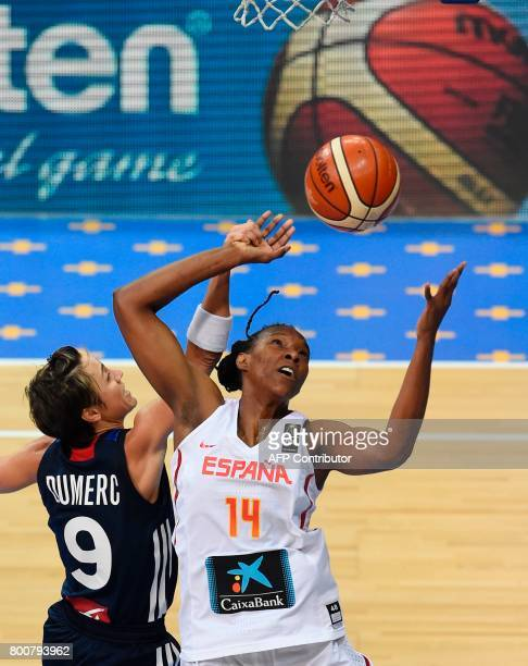 Celine Dumerc of France tries to block Sancho Lyttle of Spain during the FIBA EuroBasket 2017 women's final match between Spain and France in Prague...