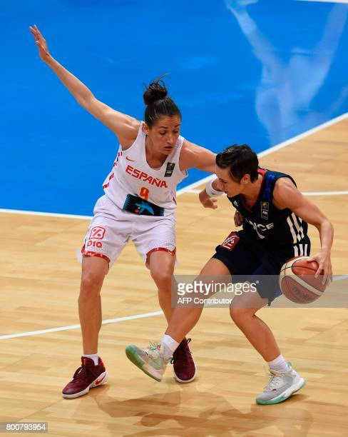 Celine Dumerc of France vies for a ball with Laia Palau of Spain during the FIBA EuroBasket 2017 women's final match between Spain and France in...