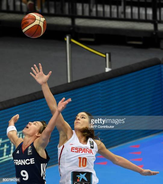 Celine Dumerc of France vies for a ball with Marta Xargay of Spain during the FIBA EuroBasket 2017 women's final match between Spain and France in...